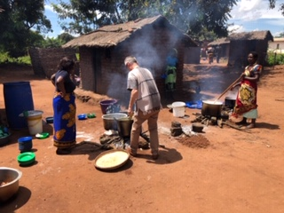Cooking food for a community training event, paid for by Links International.