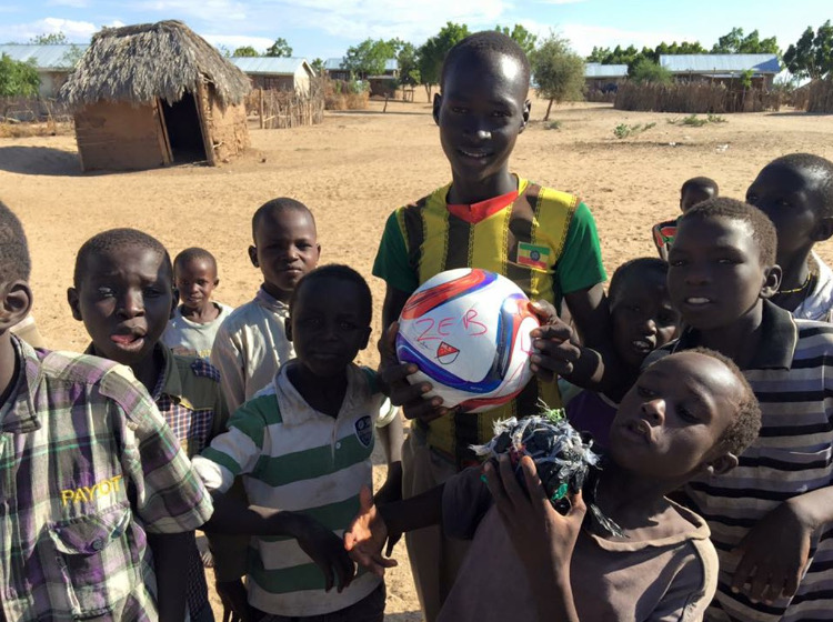 Zeb Montgomery battled leukaemia for 18 months and finally died in November 2015. He was 14. Zeb loved football and before he died he asked that as many footballs as possible be distributed to kids in the developing world in his name.   Caroline Read writes: During our charity work in Africa we often see groups of children and teenagers playing football with a 'ball' made up of rags they have tied together. For most of them to own a football would be an impossible dream. In April and June 2016 we visited Malawi and Zambia and took footballs to personally distribute to kids in the communities where we work. The Zeb Foundation started us off with 40 and we were able to take more thanks to people donating through Communicate-ed's online Resources Shop.
