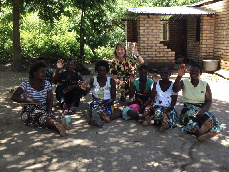 Caroline with part of a 'village banking' group in Malawi - another strategy aimed at providing sustainable growth for the poorest people.